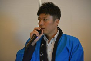 まつづくり委員会 赤峰友和副委員長により、事業全体の流れと各部会の動きの説明が行われました。